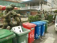 济南仲宫艺术街两组雕塑遭垃圾桶围堵